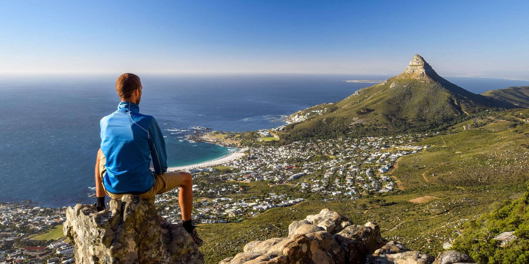 Person on a mountain looking at Cape Town