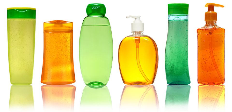 Colourful plastic bottles for liquids - one of Skyscanner's top packing tips is to use cling-film and tape to prevent liquid leaks