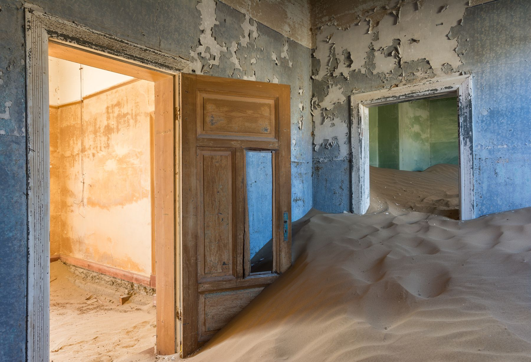 Building full of sand in Kolmanskop, and abandoned city in Namibia
