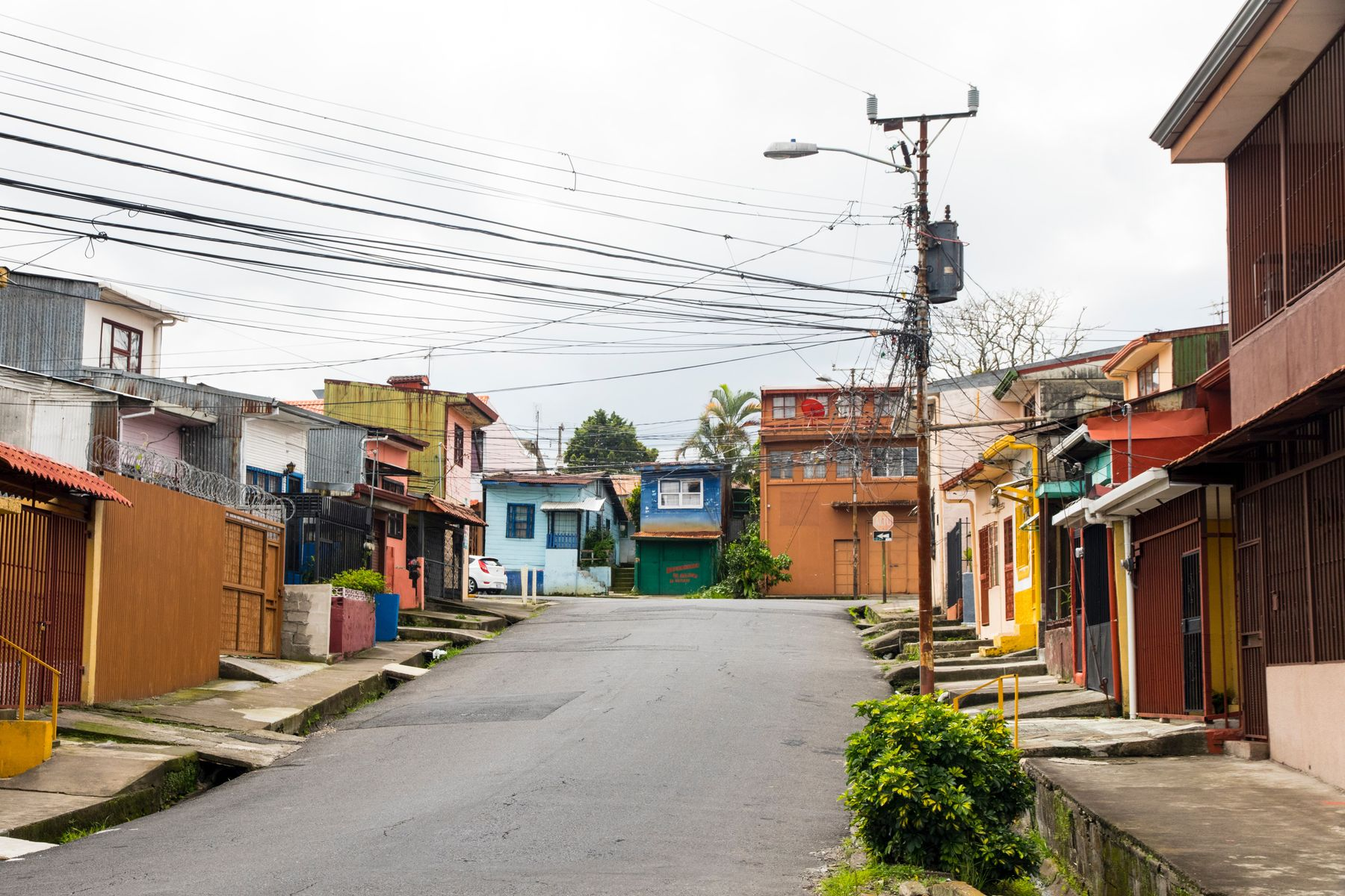 Quiet street with colourful buildings in San Jose. Costa Rica is open to travellers from Canada.