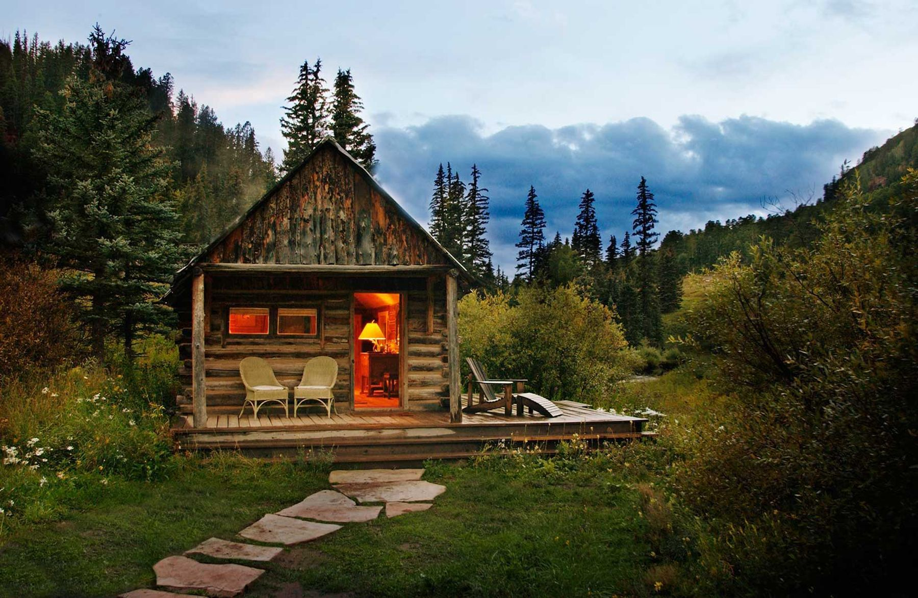 a small cozy cabin surrounded by the forest
