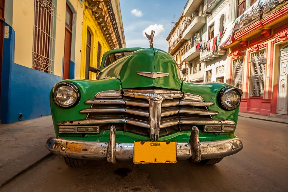 green classic American car parked on the streets of Havana, Cuba