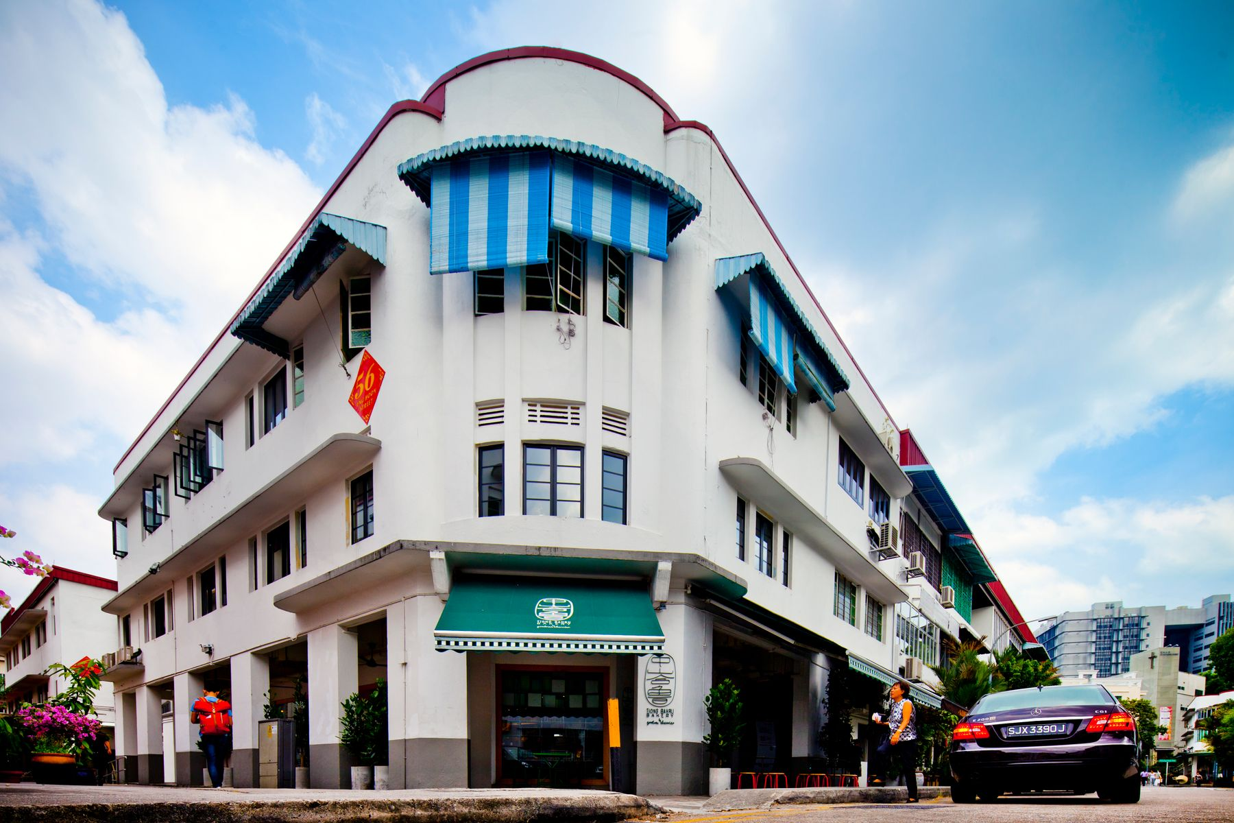 Corner building with car parked outside in Tiong Bahru neighbourhood, Singapore
