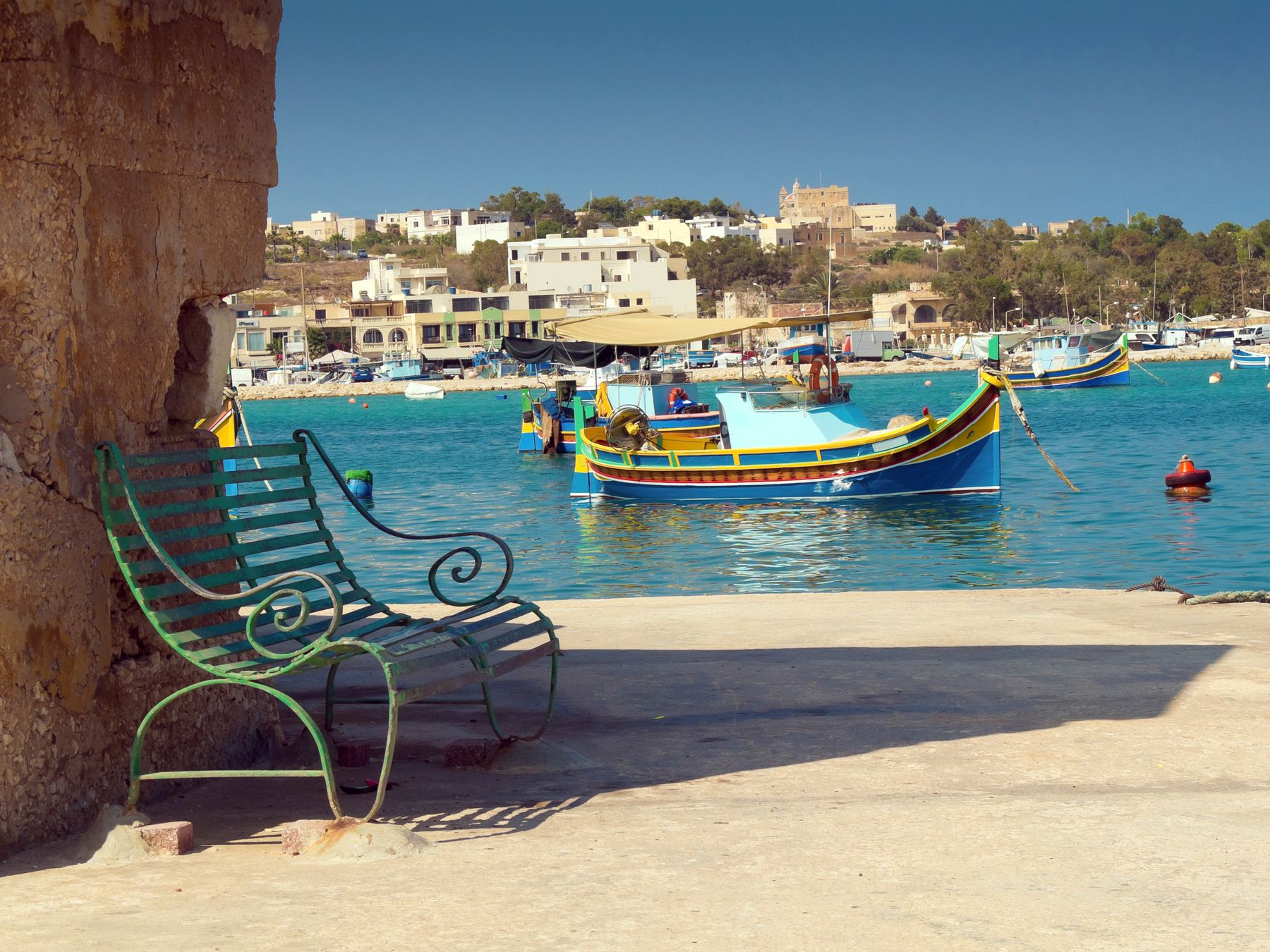 Colourful boat floating in a Malta harbour.