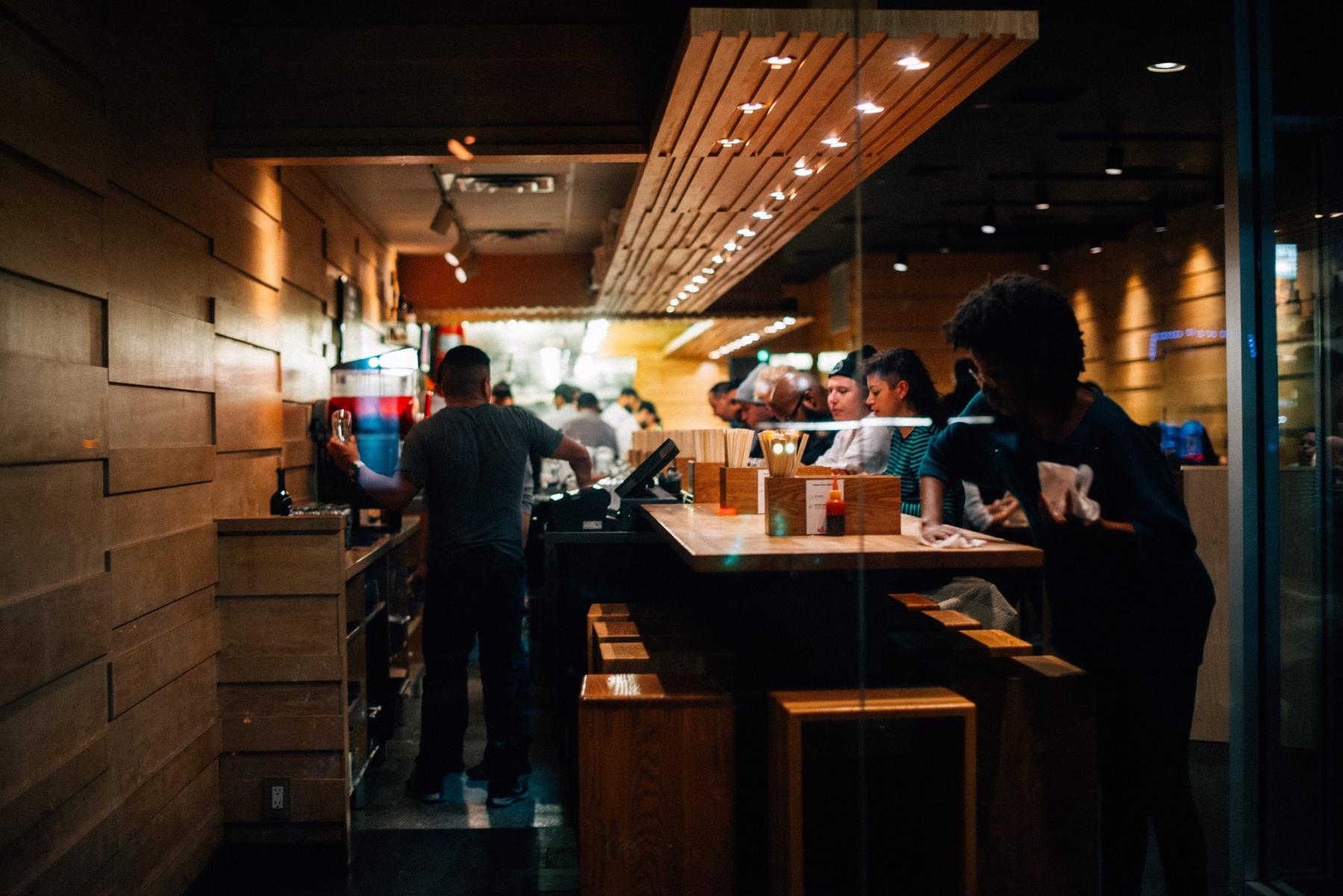 window view of momofuku restaurant in new york city at night