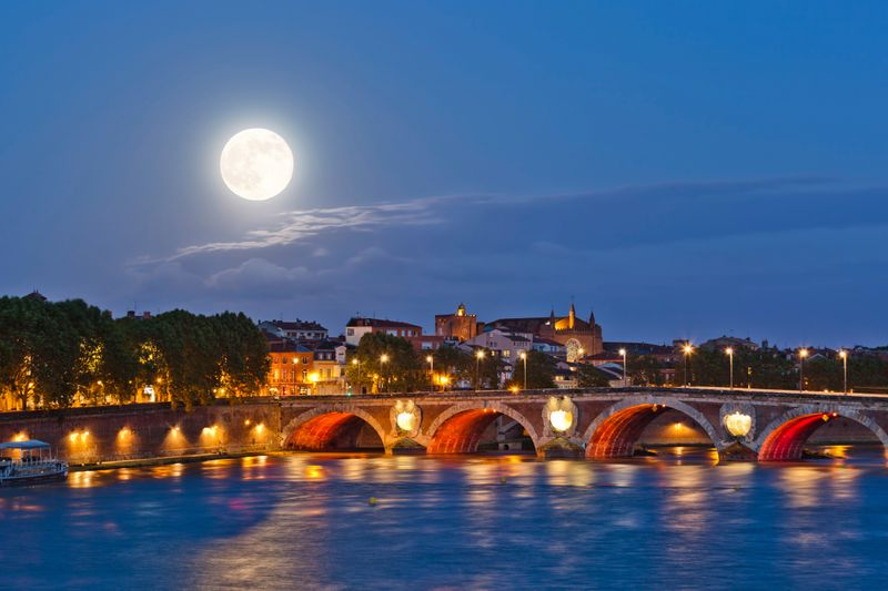 A nighttime shot of Toulouse, seen over the river
