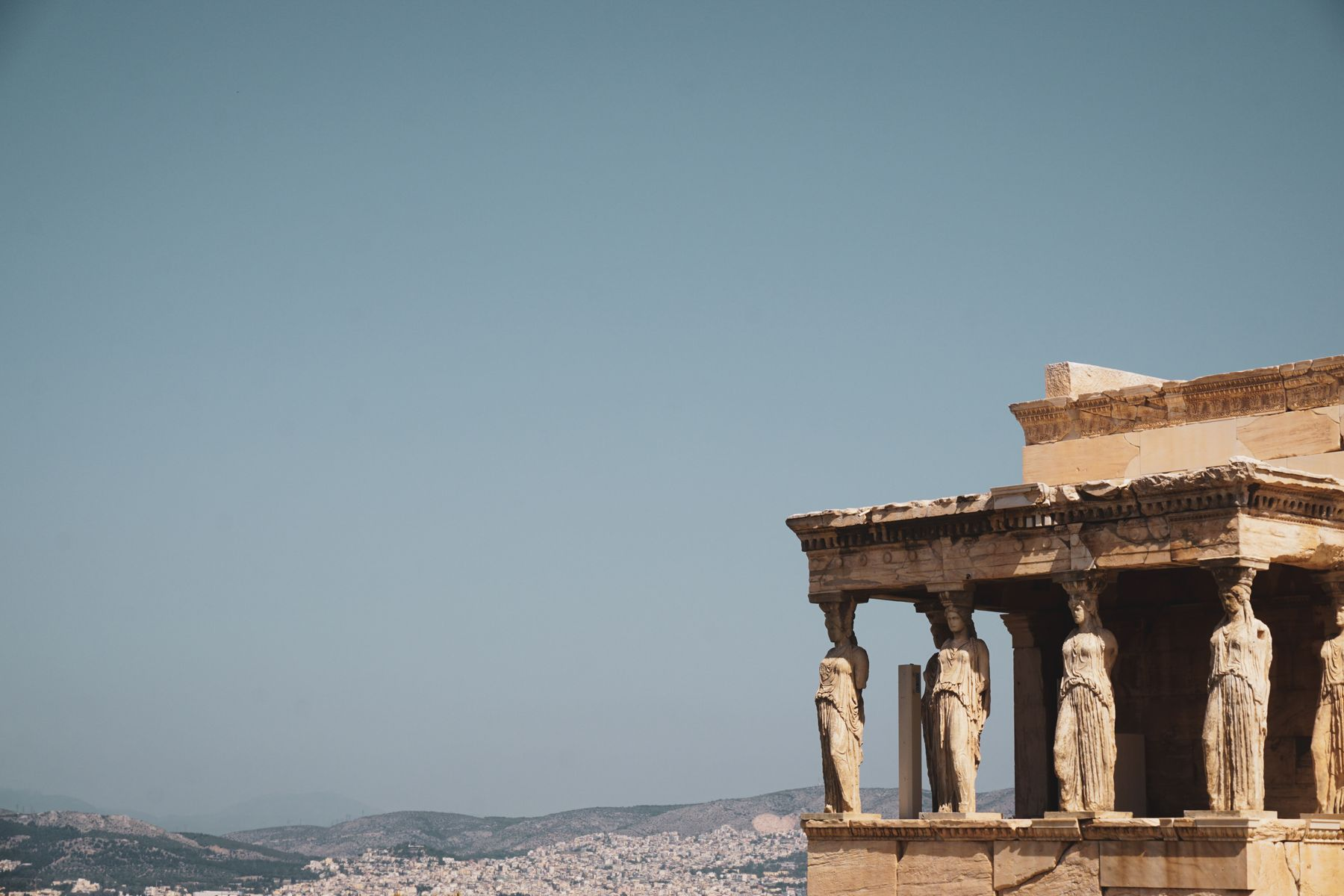 Caryatides at the Acropolis ruins in Athens. Outdoor attractions for your vacation to Greece
