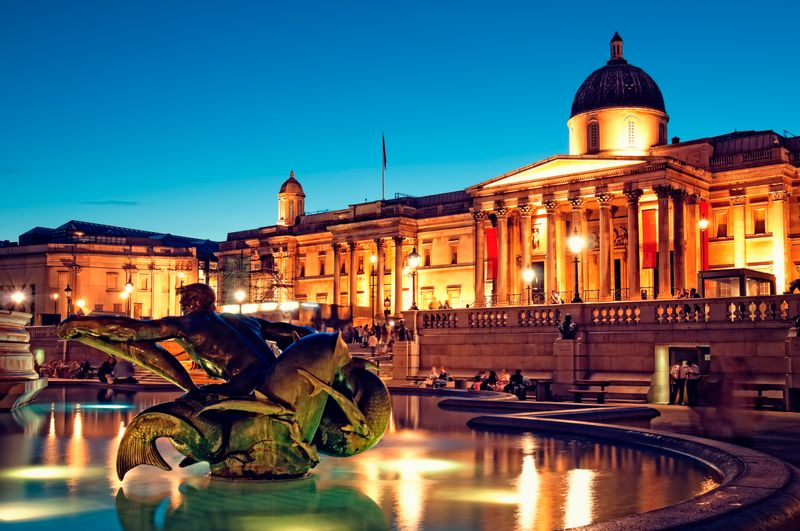 National Gallery and close-up of a fountain at dusk.