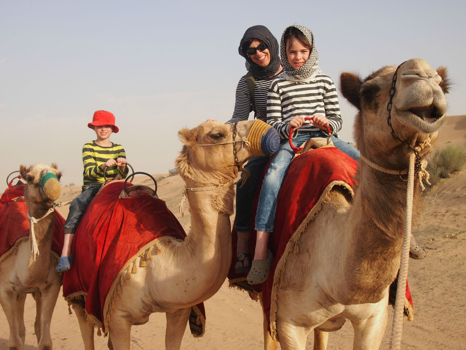 World Travel Family riding on camels