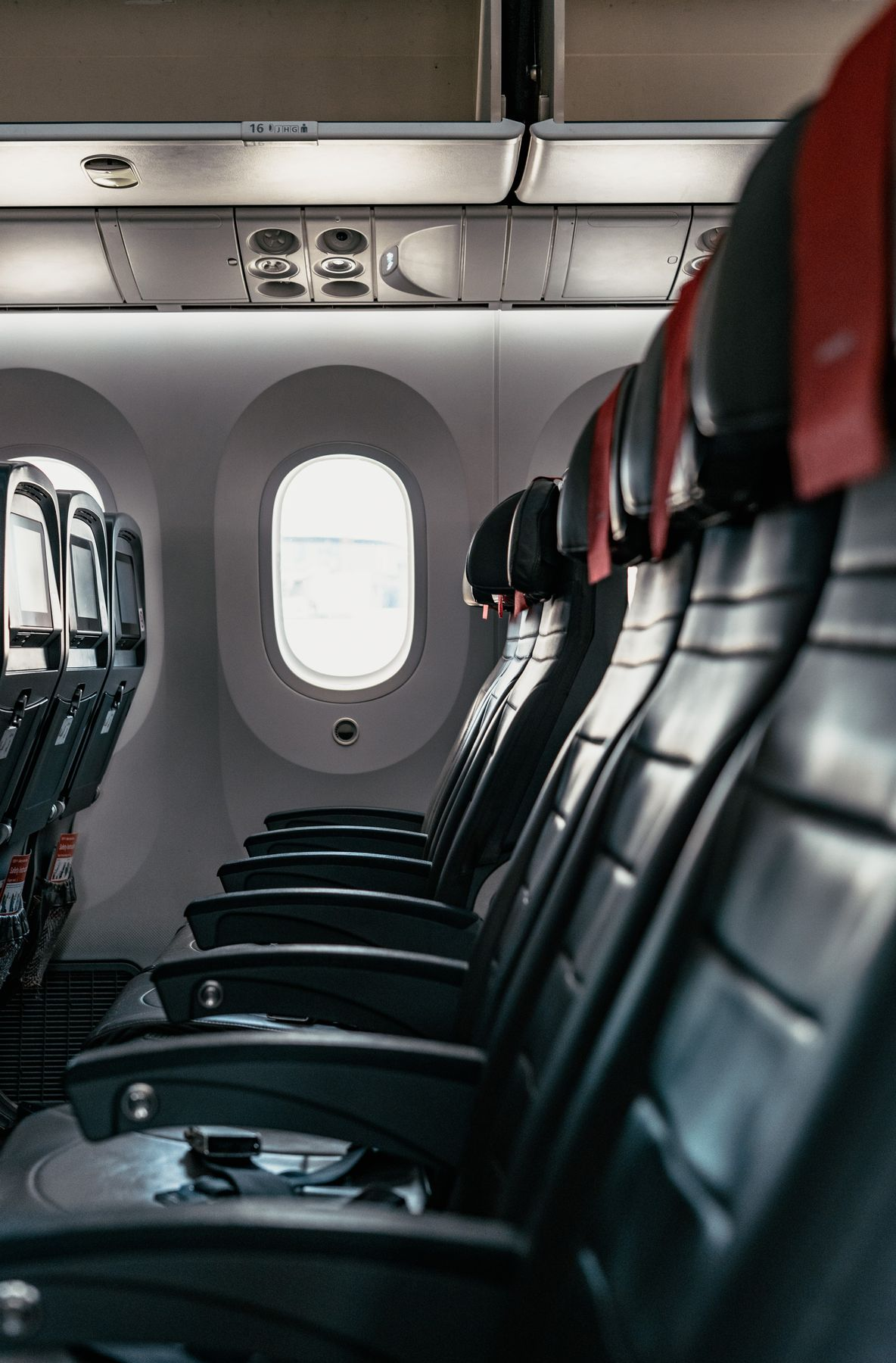 Row of empty seats in an airplane, flying during coronavirus outbreak