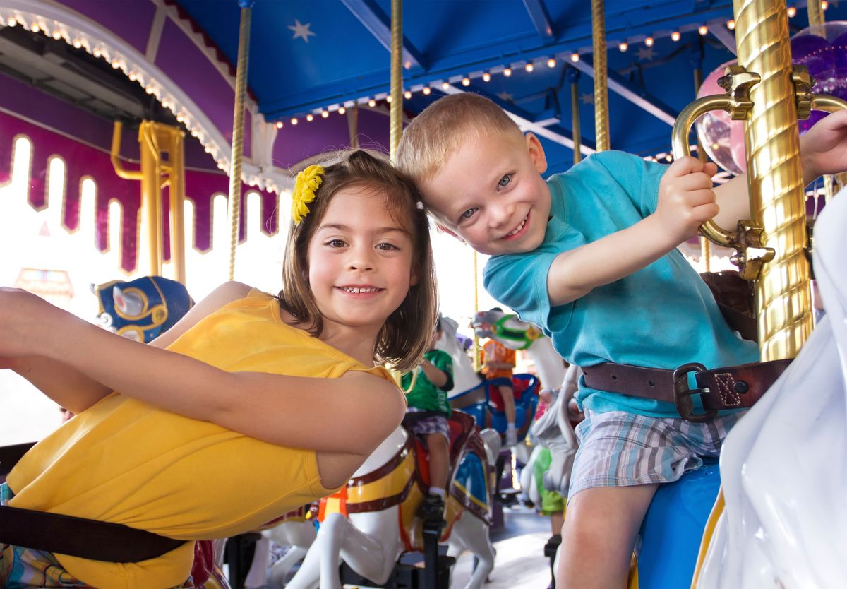 Two kids on a carousel in Florida, USA