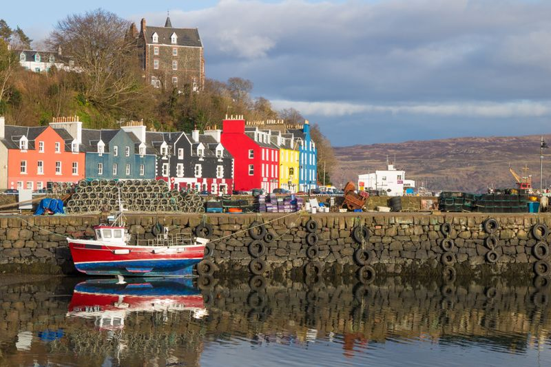 Village harbour with colourful houses in a row
