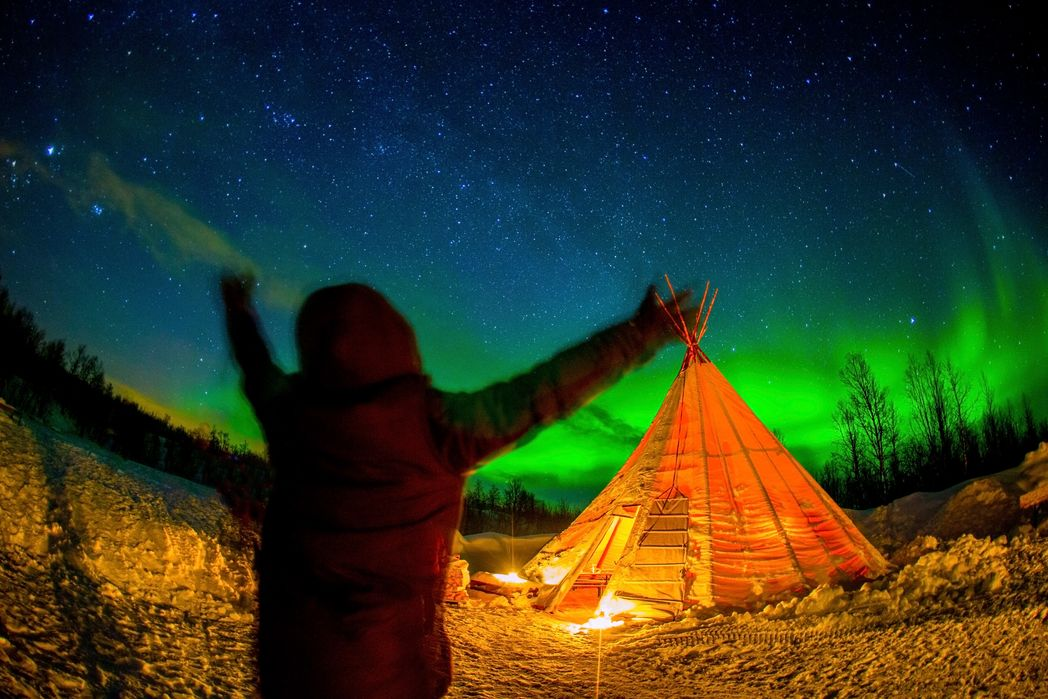 Traveller spotting the Northern Lights in Norway
