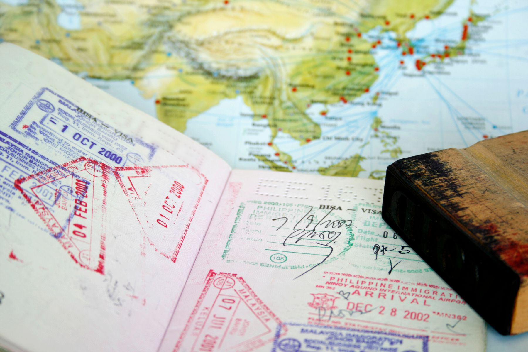 Passport stamps and world map