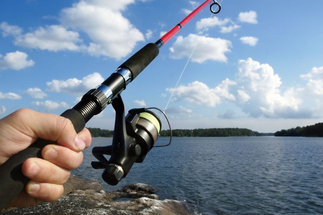 Someone fishing on a lake.