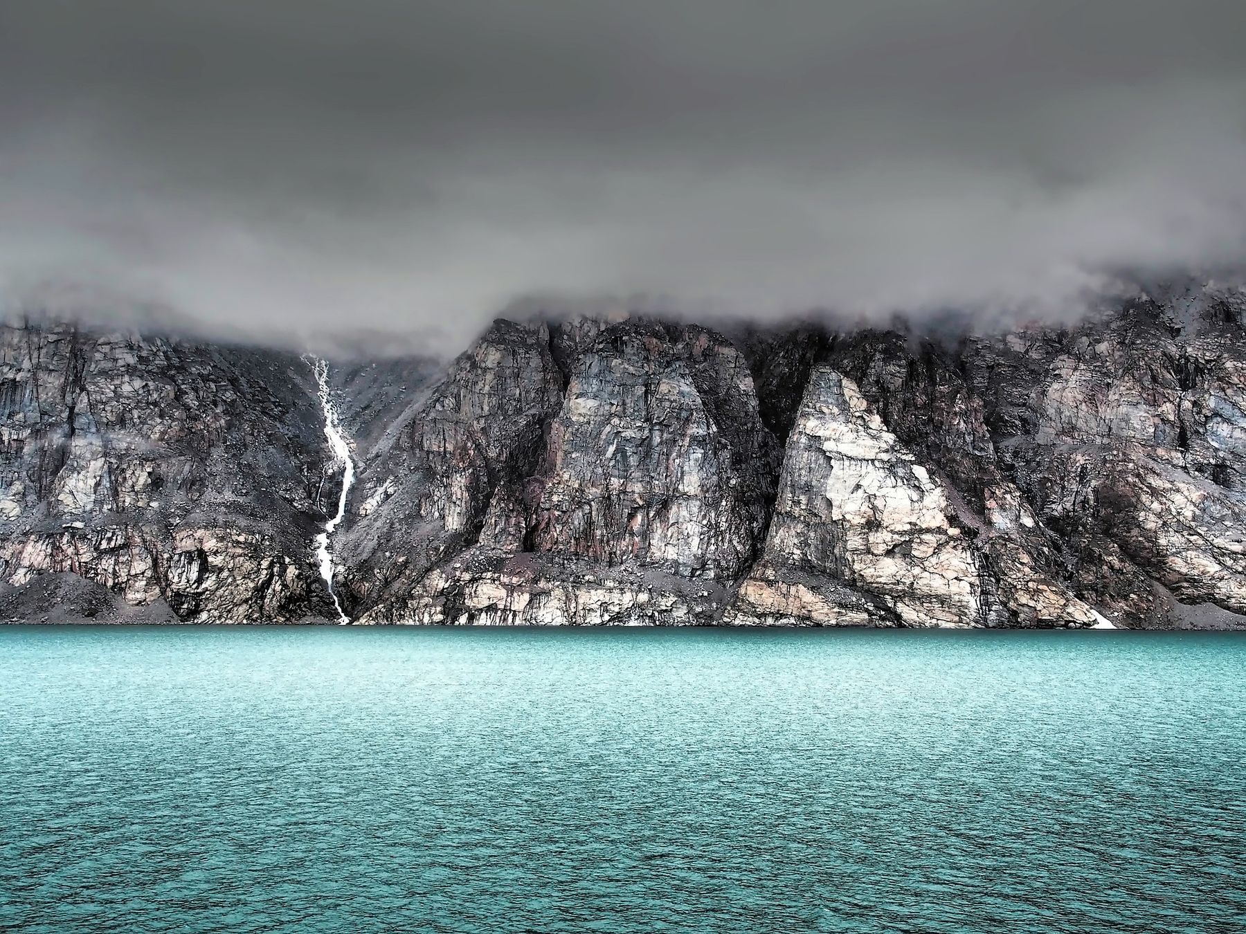 clouds, rocks, and sea in Baffin Island, a large and remote island in Canada