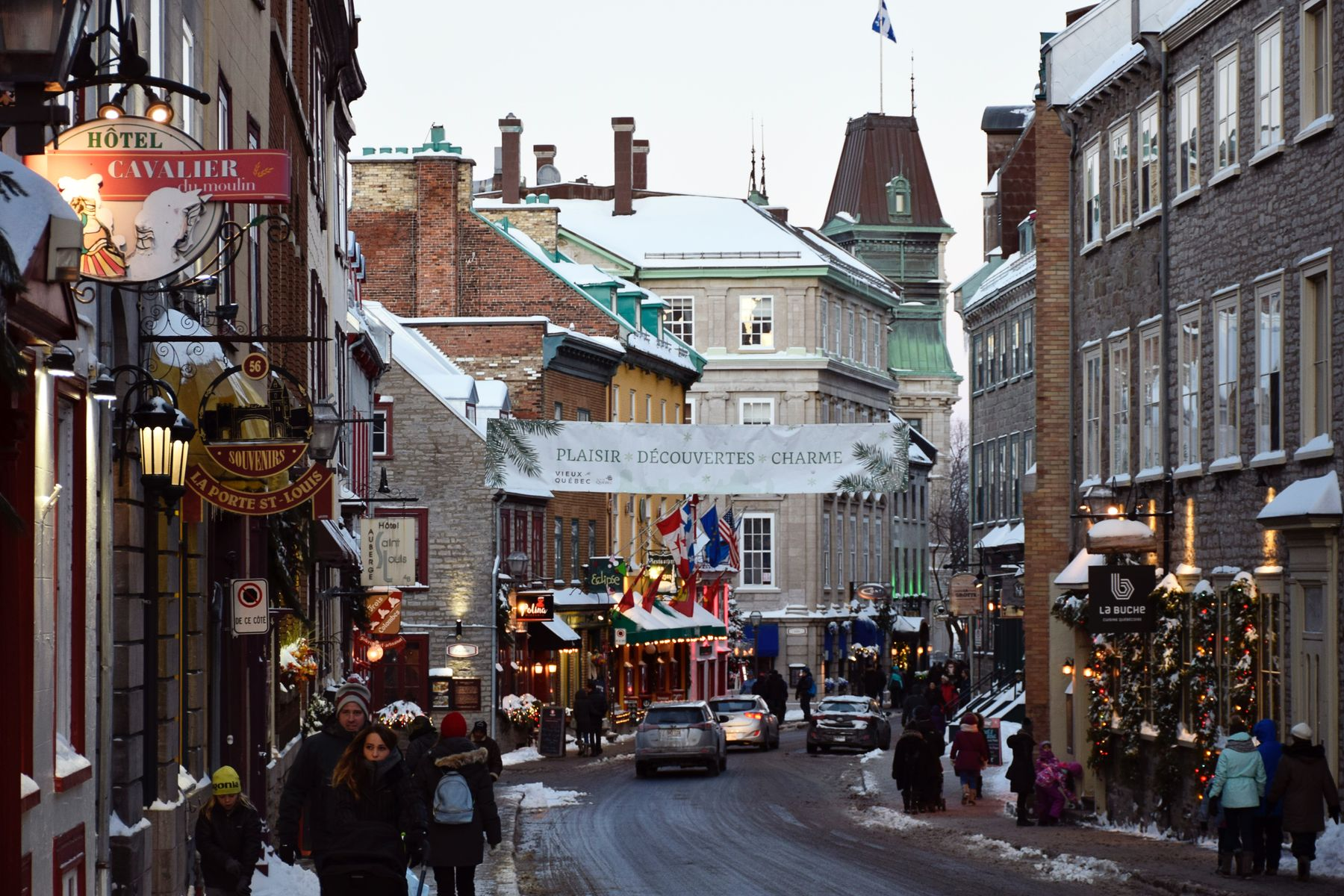 tourists walking along a commercial street in Old Quebec in winter