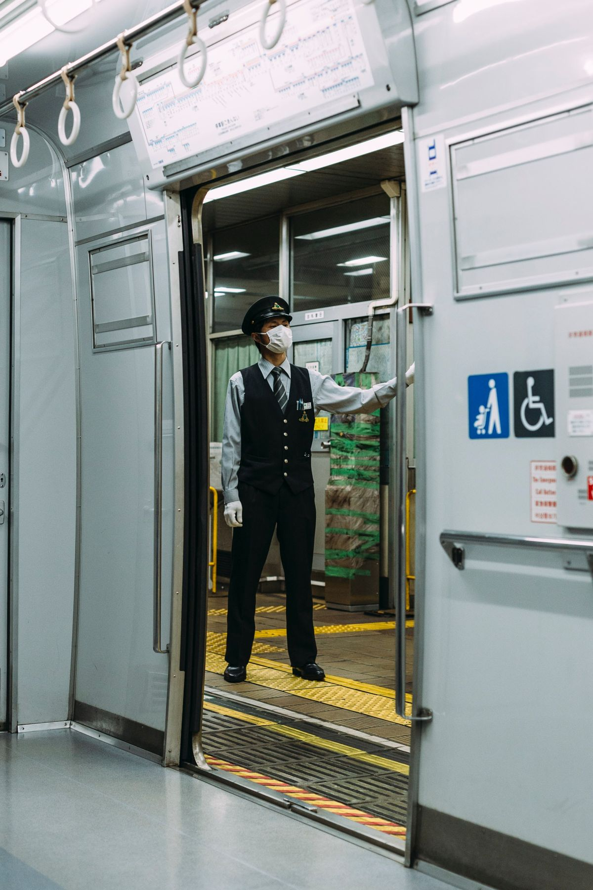 person standing in public transportation with a face mask