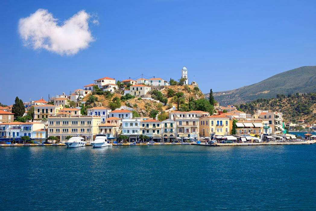 Houses and tower of Poros, Saronic Islands - best Greek Islands to visit in winter