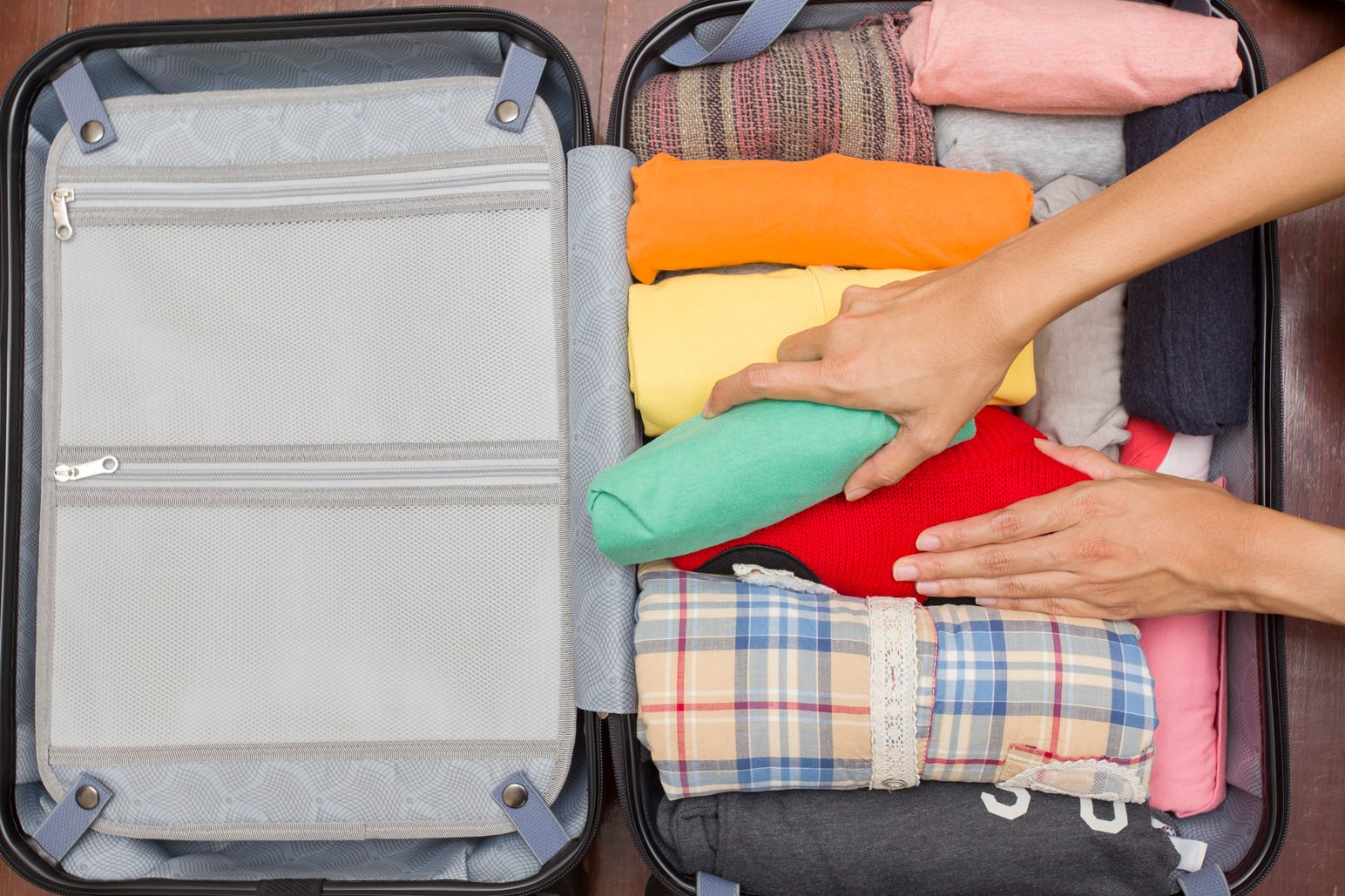 Rolling clothes into hand luggage - Flybe baggage allowances and how to beat extra charges