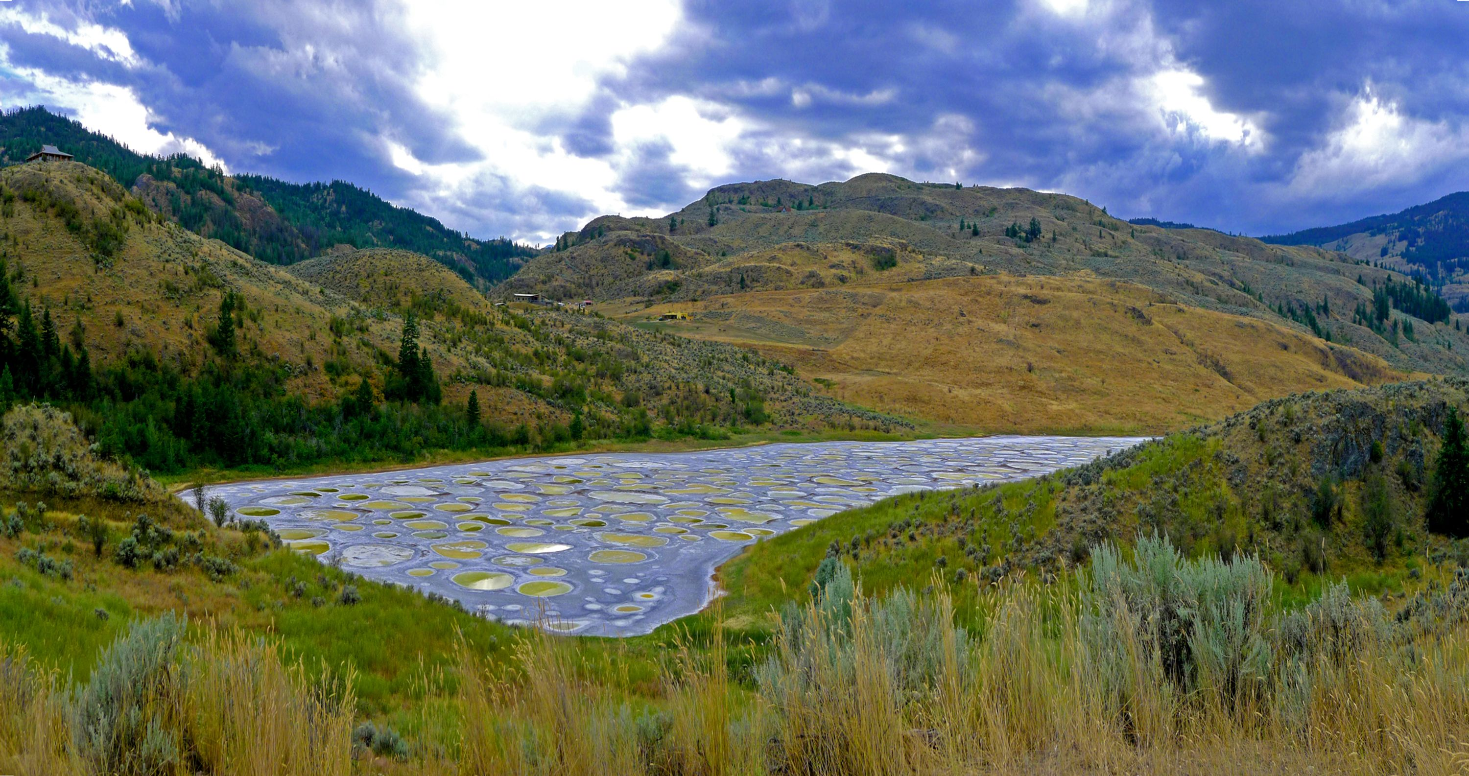 View of spotted lake, a sacred abandoned place in Canada, on a bright but cloudy day.