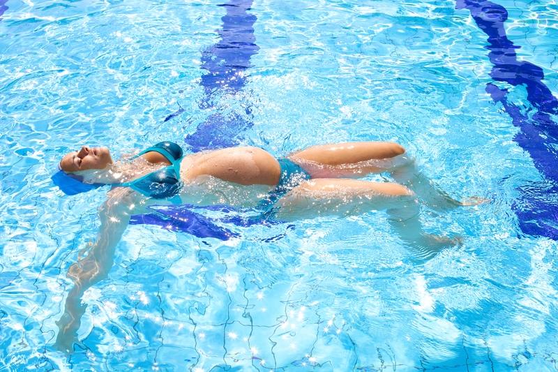 Swimming pregnant woman