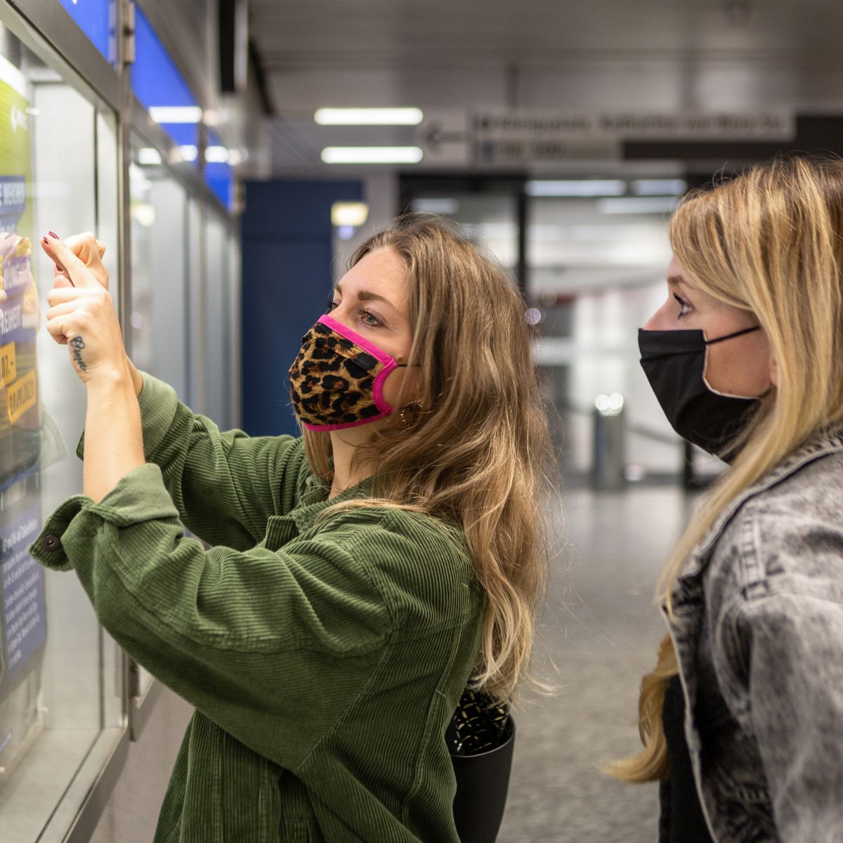 two women in masks in the new world of travel