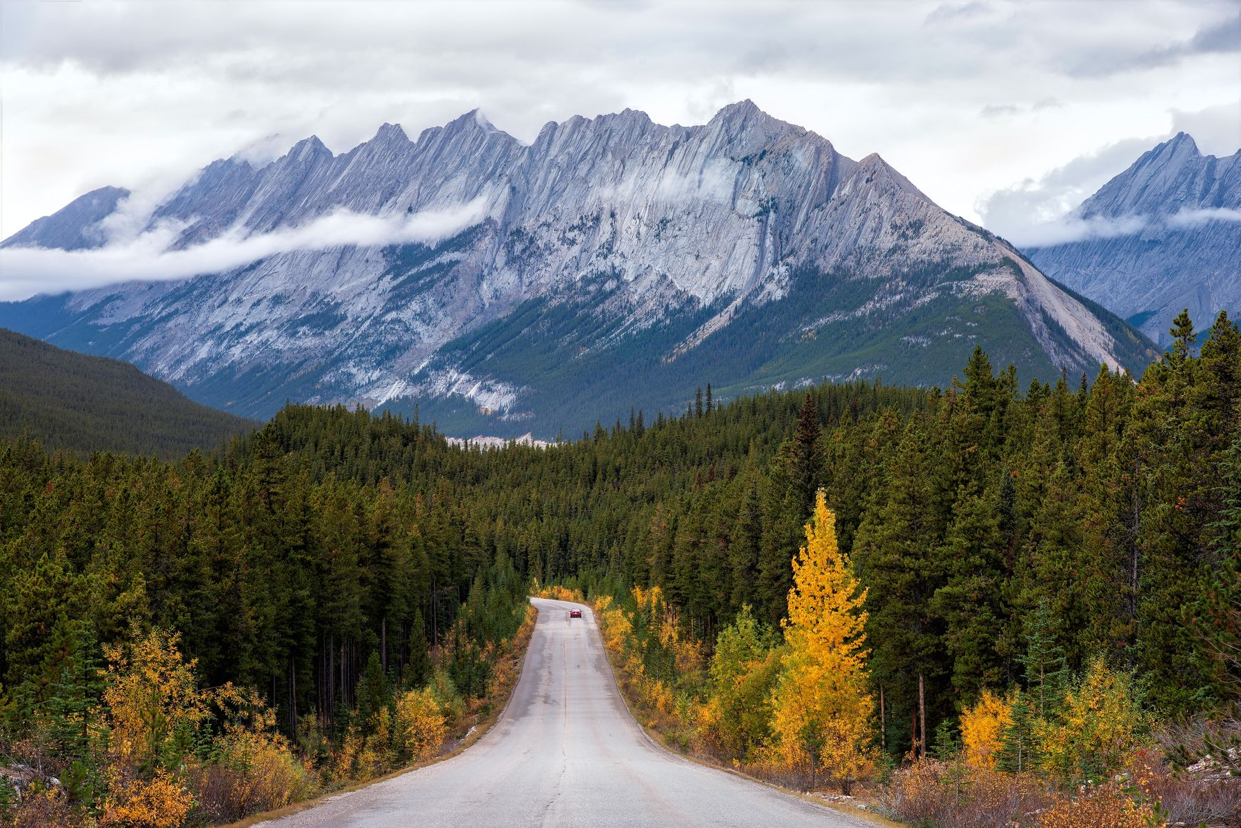 an open road with a grand mountain in the background of Jasper National Park, a great place to visit in Canada during the summer