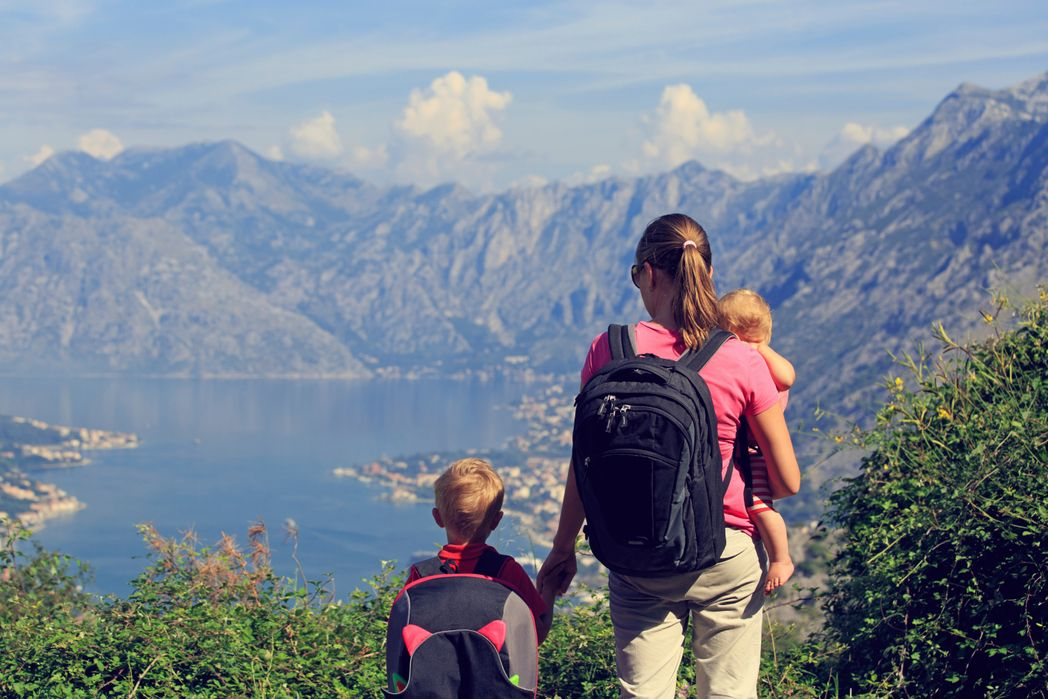 Mother and two children soaking up the view in Montenegro