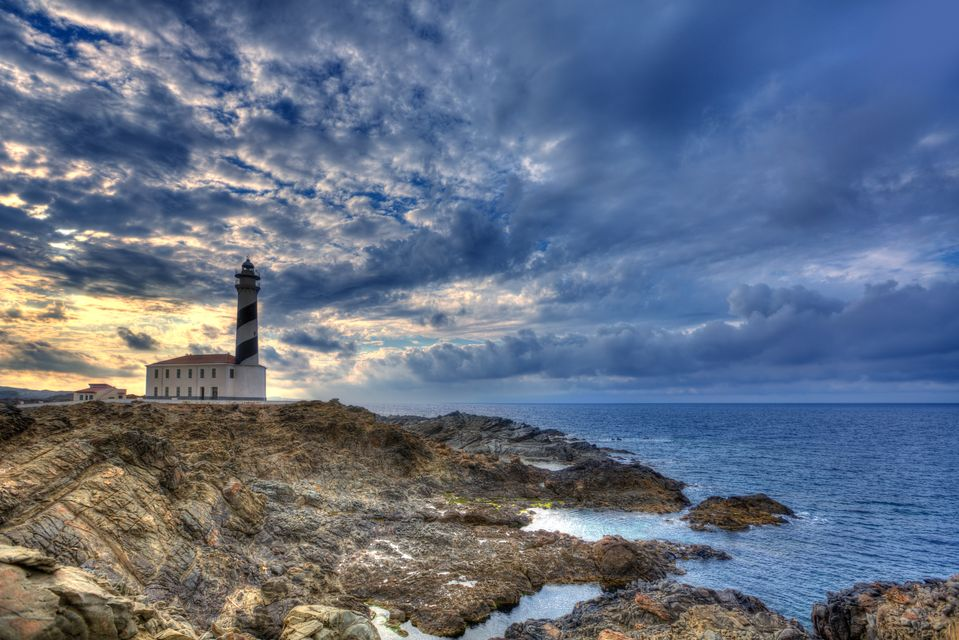 Sunset in Favaritx Lighthouse, one of the best places in the Balearic Islands