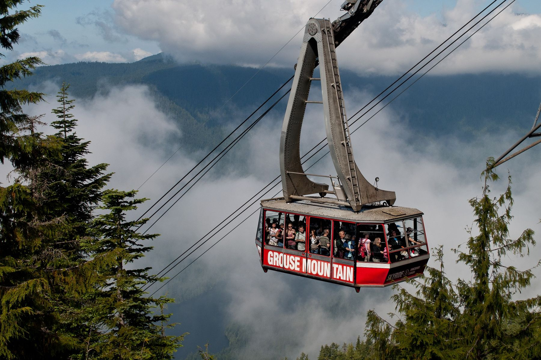 Hiking in Vancouver A picture of the Grouse Mountain gondola with trees and low clouds