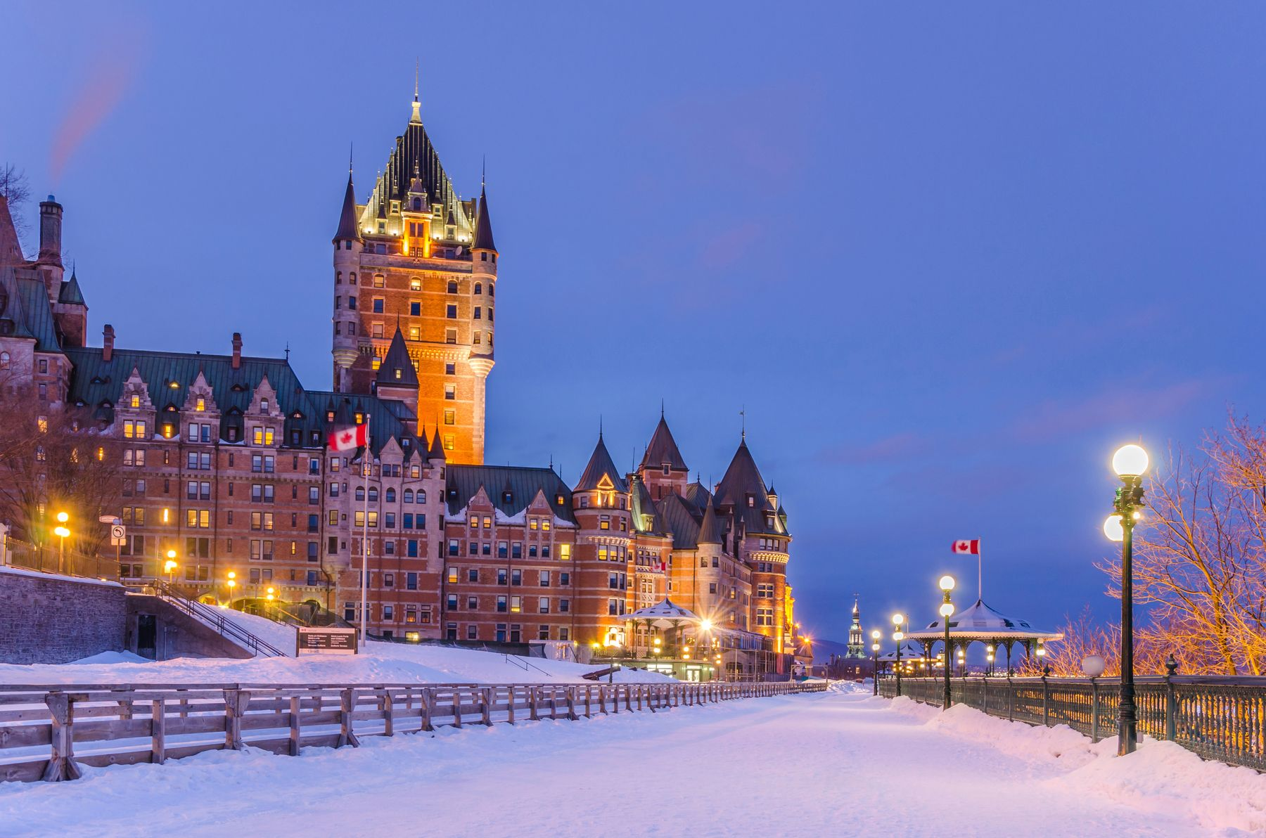 a picture of the Fairmont Château Frontenac lit up at night, a top destination for Christmas vacations