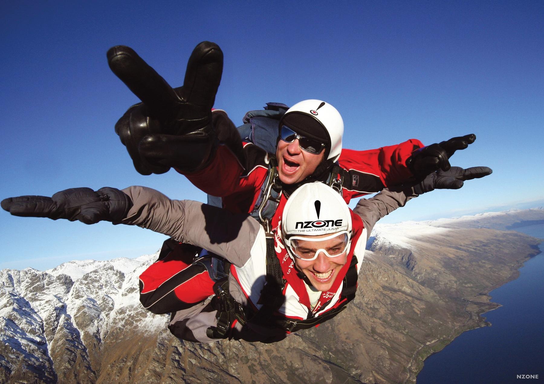 skydivers over Queenstown, New Zealand