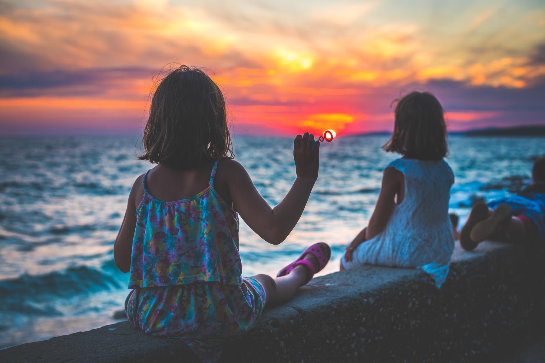 Two young girls watching the sunset in Croatia