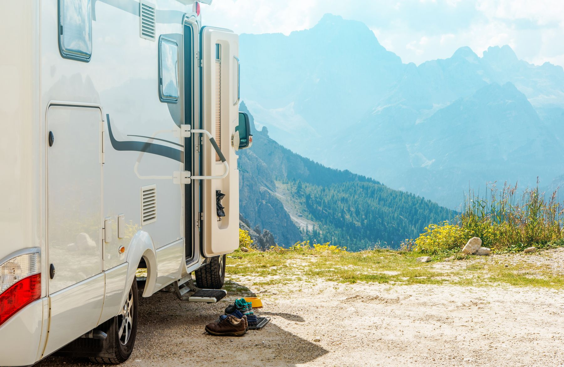 a camper trailer in front of the mountains