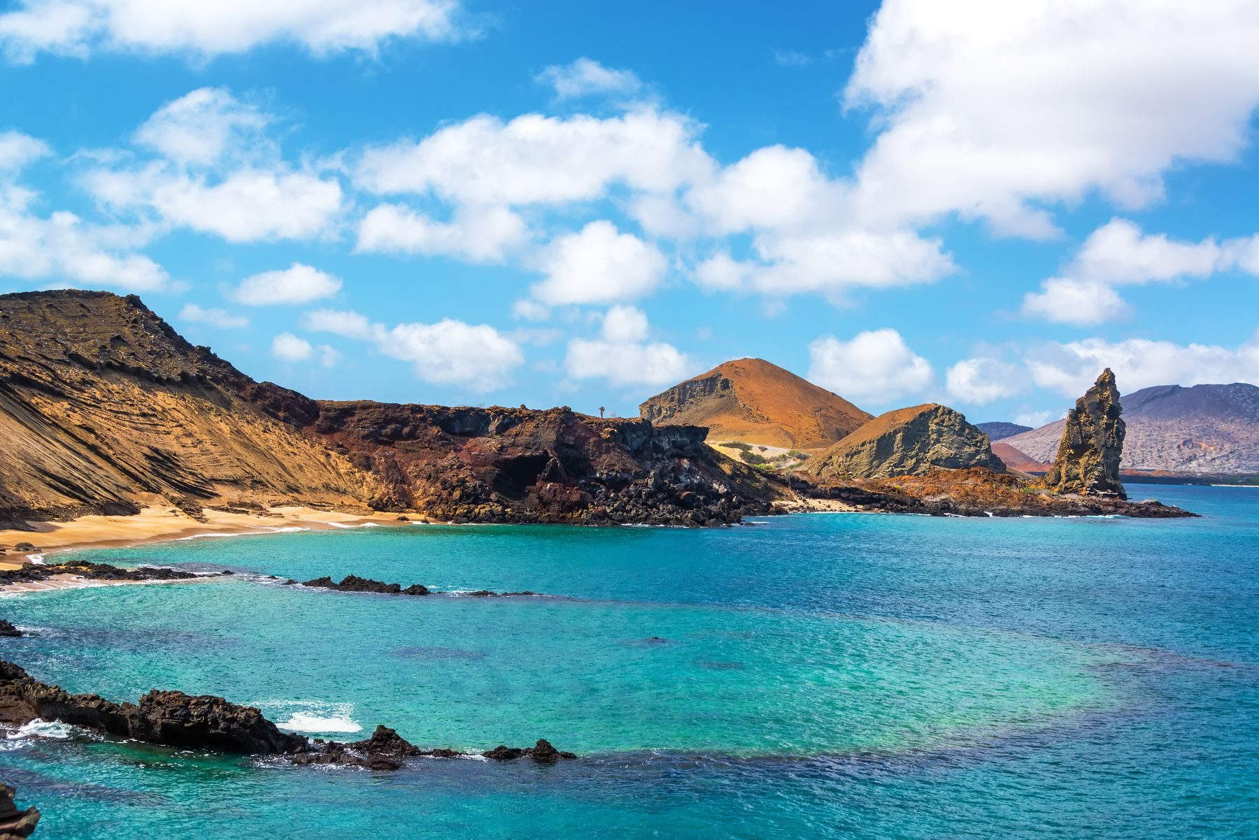 The Galapagos Islands, an ecotourism destination, showing its blue waters and coastline