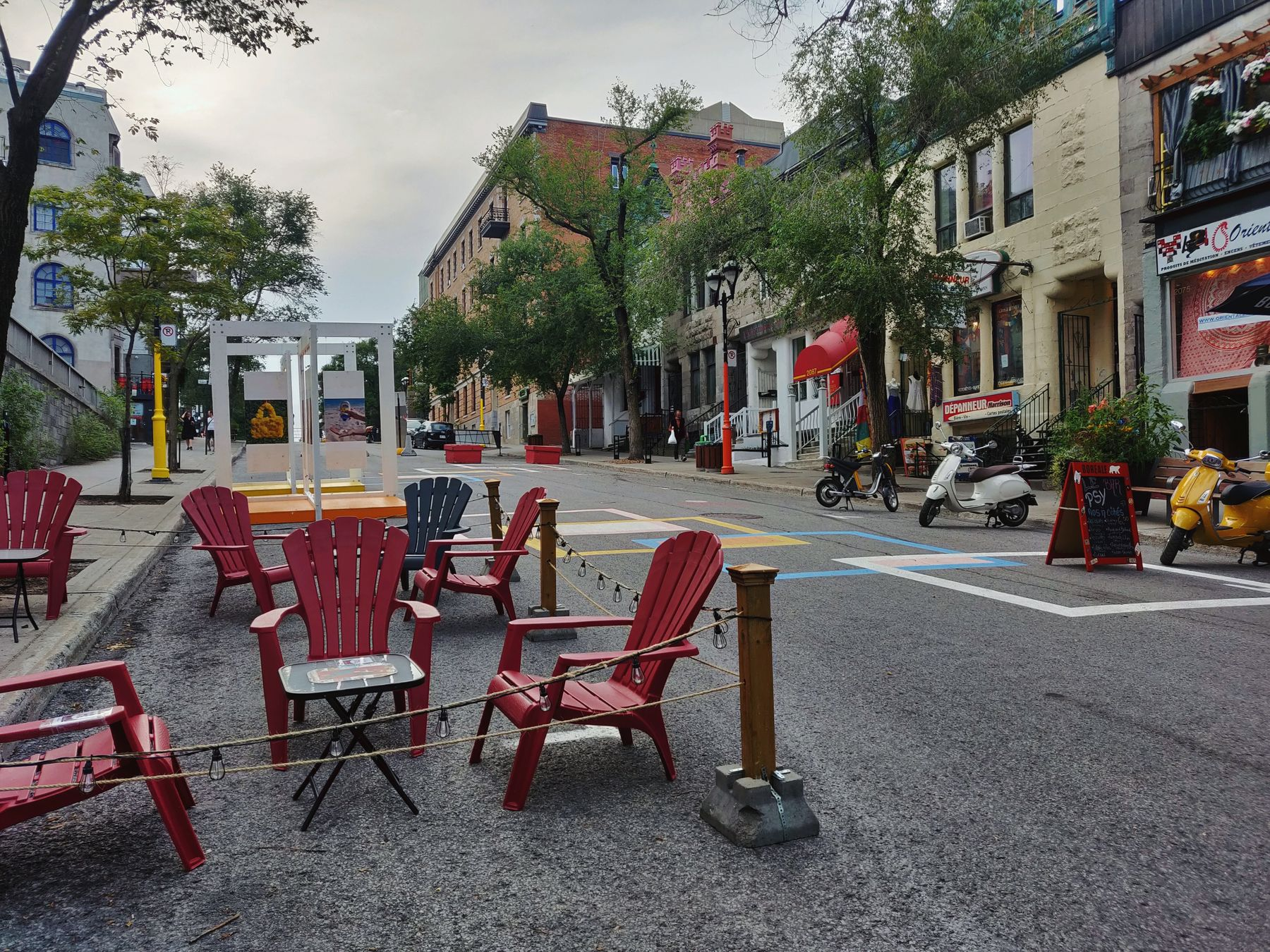 chairs set up for physical distancing on St-Denis street in Montreal during the pandemic