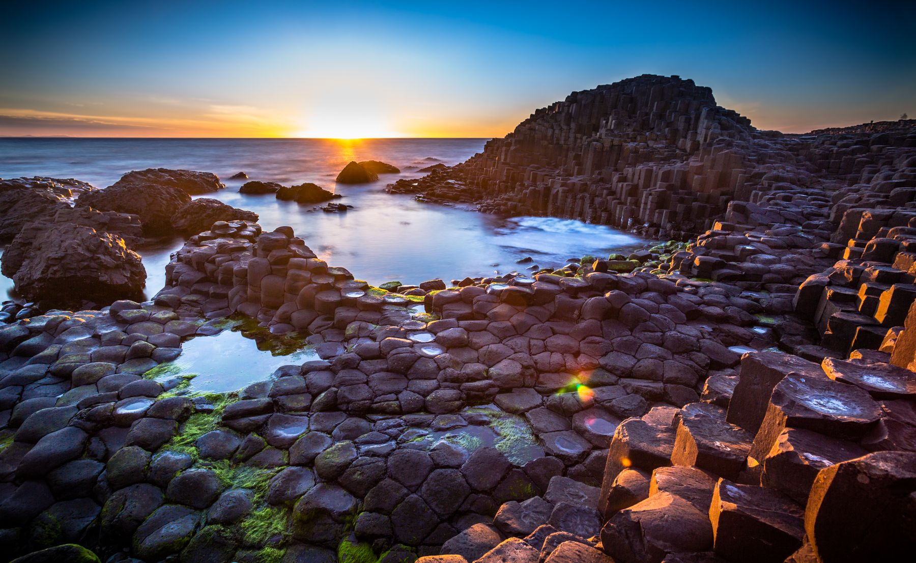 Belfast coastal view of Giant's Causeway at sunset