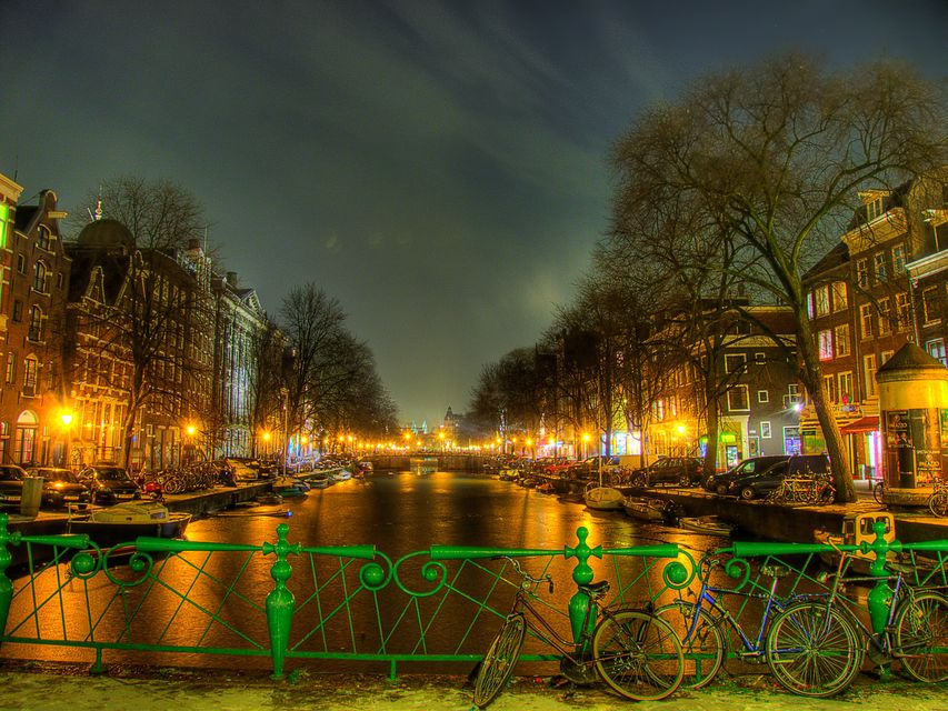 Amsterdam illuminated at dusk - one of the best party holiday destinations in Europe