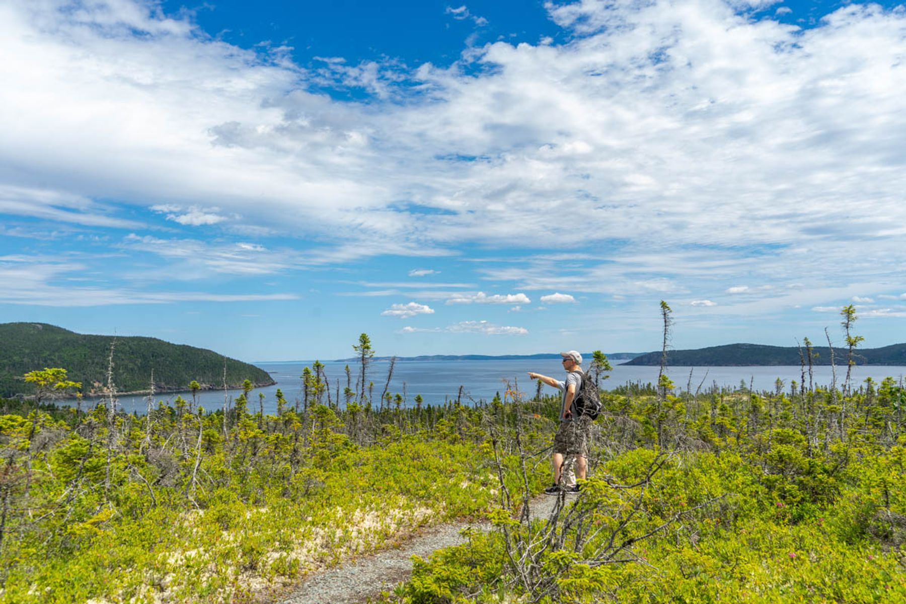 hiker walking along the Damnable Trail in the Eastport Peninsula in Newfoundland
