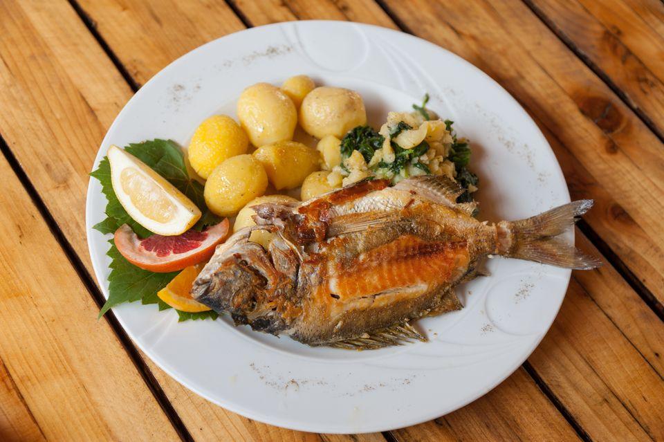 plate of fish and potatoes, Croatian cuisine