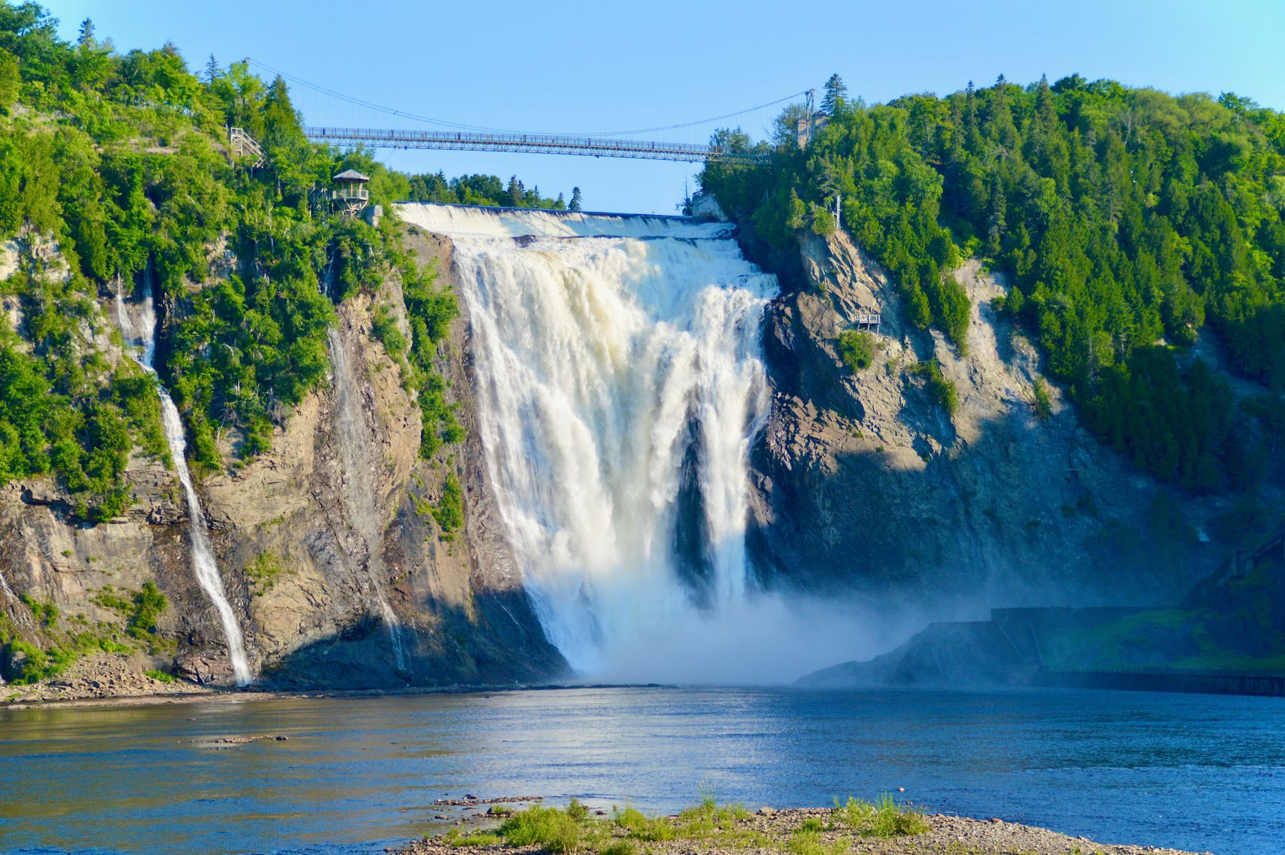 view across the river on Montmorency Falls, a popular attraction near Quebec City