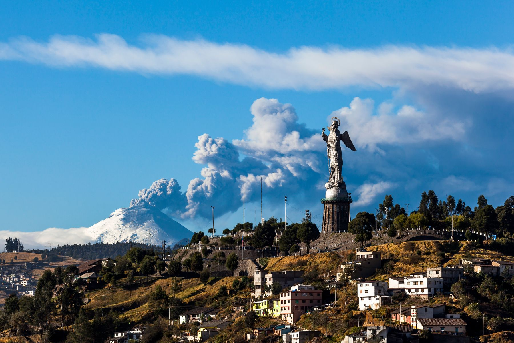 view of a mountaintop in Quito with a volcano in the background