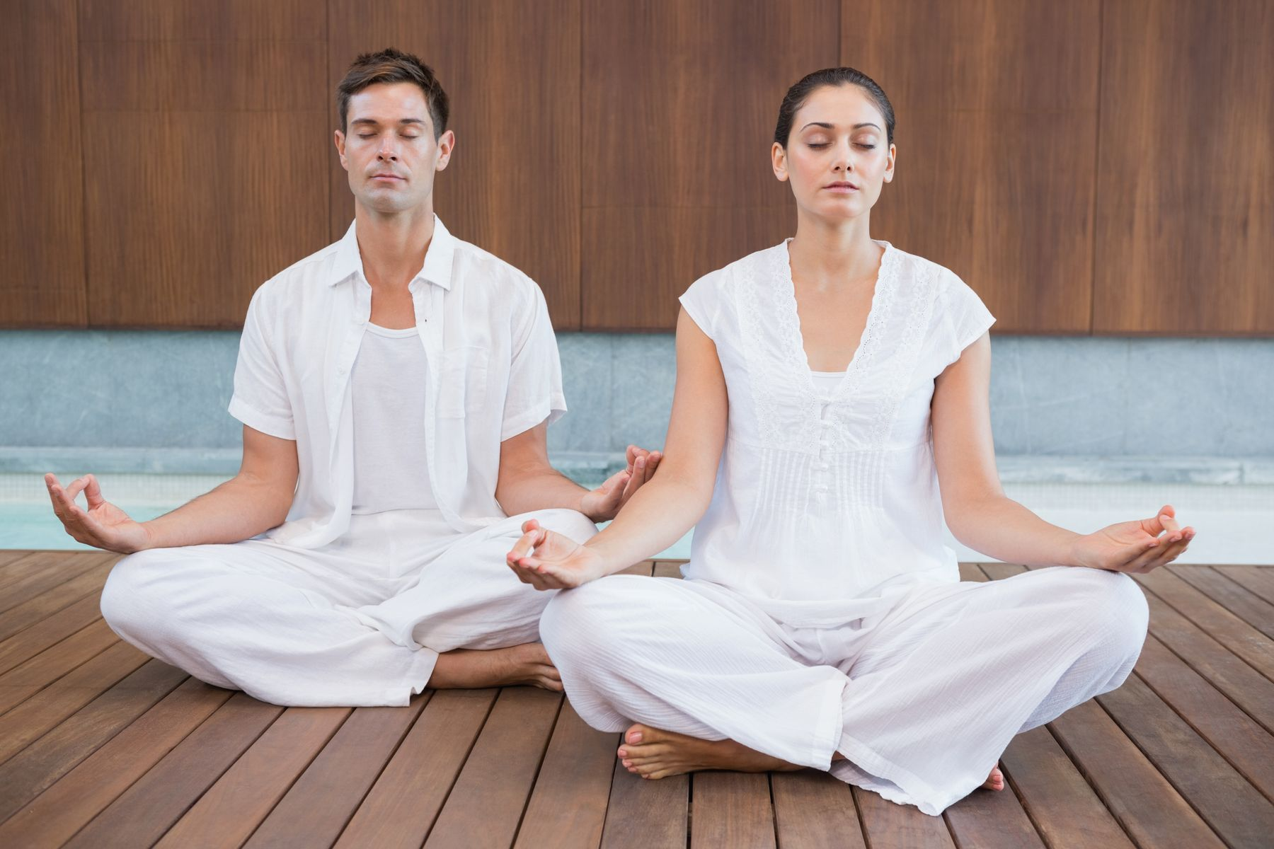 two people meditating in a peaceful space