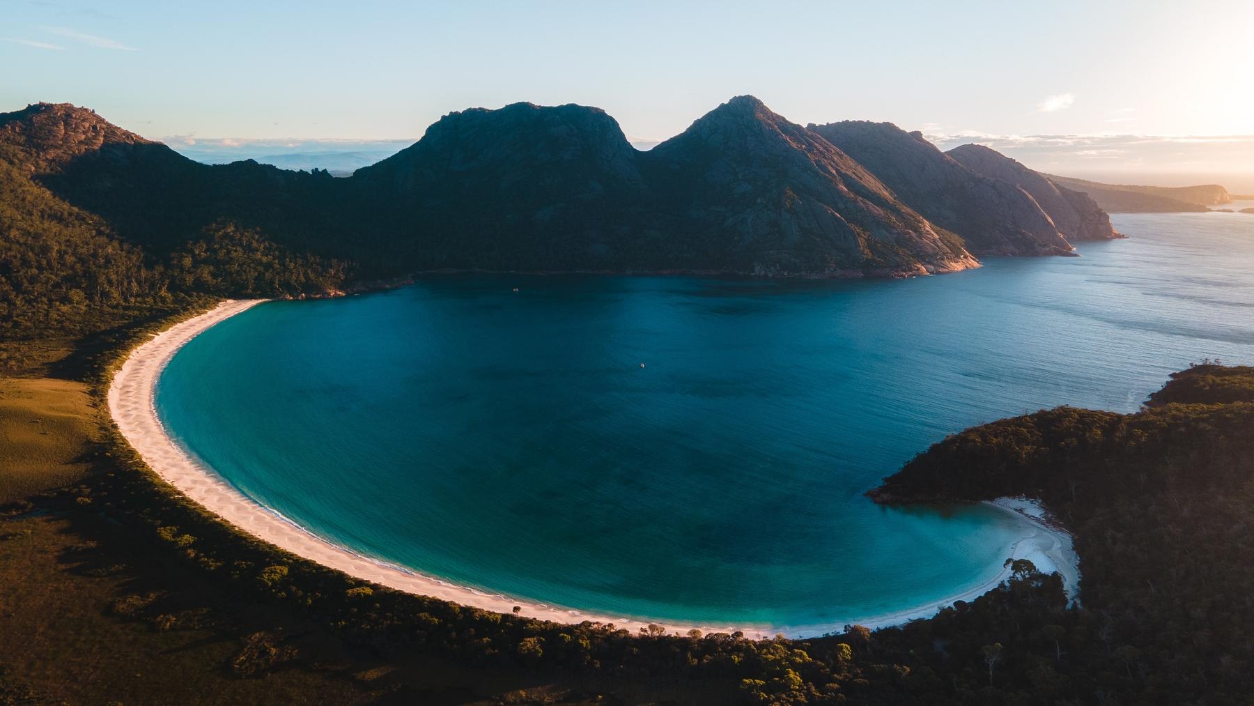 Bird's eye view of Wineglass Bay Beach in Tasmania at magic hour