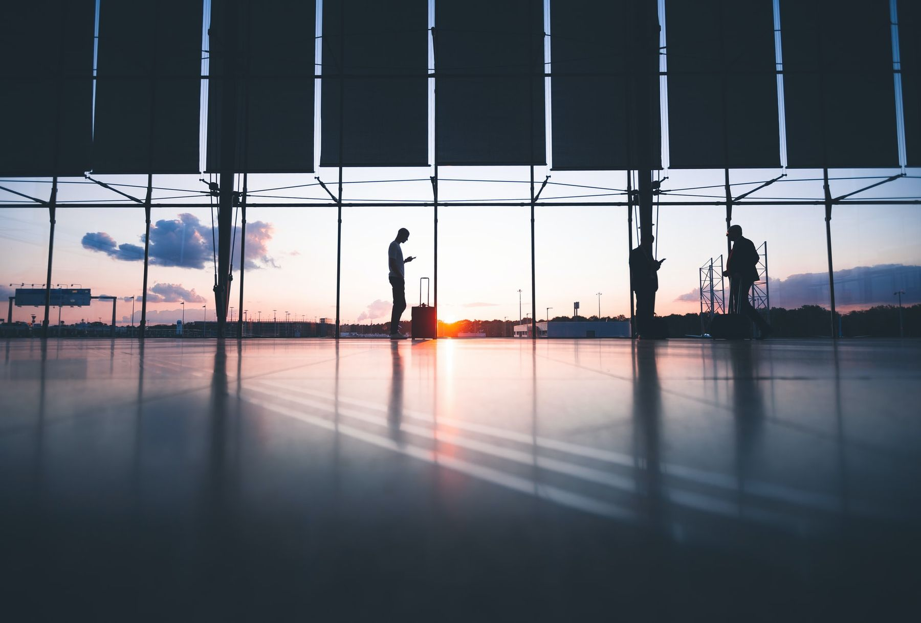 Lone figure standing in a nearly empty airport