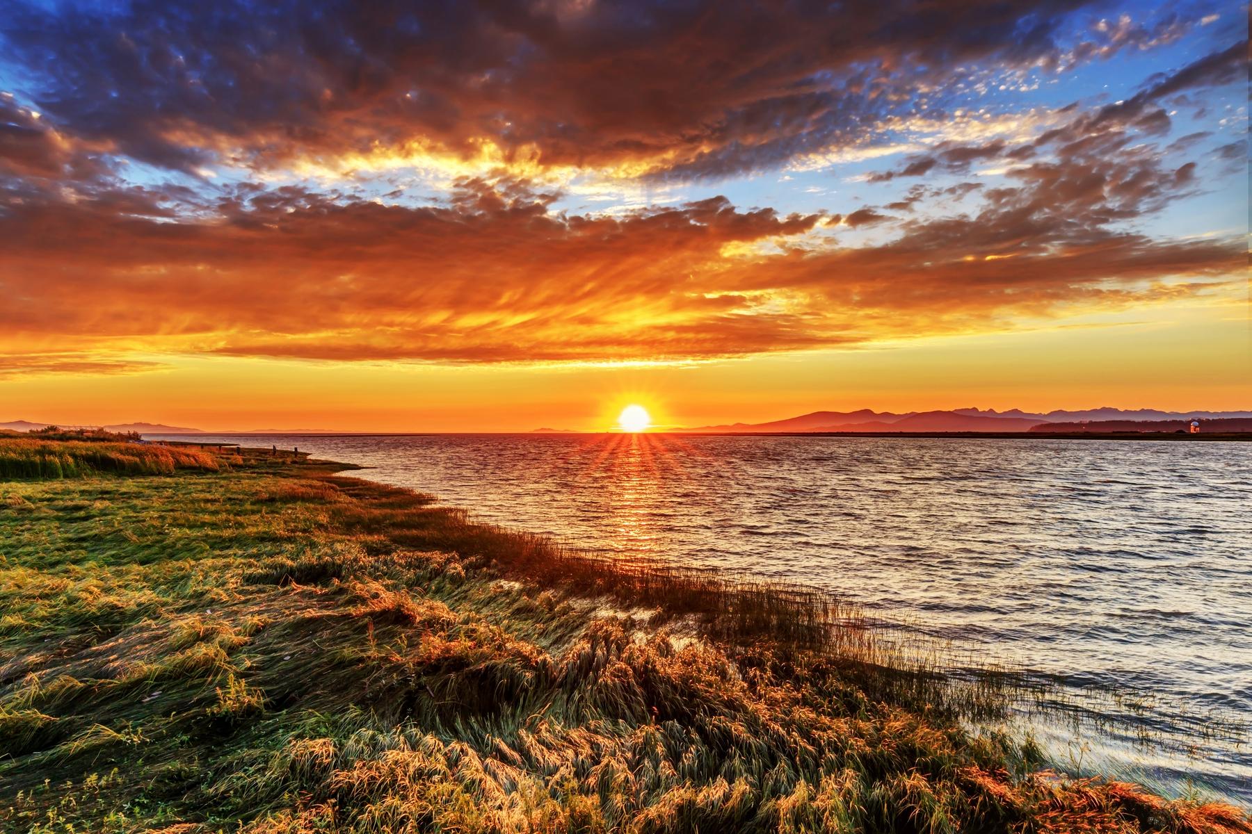 hiking in British Columbia coast by sunset