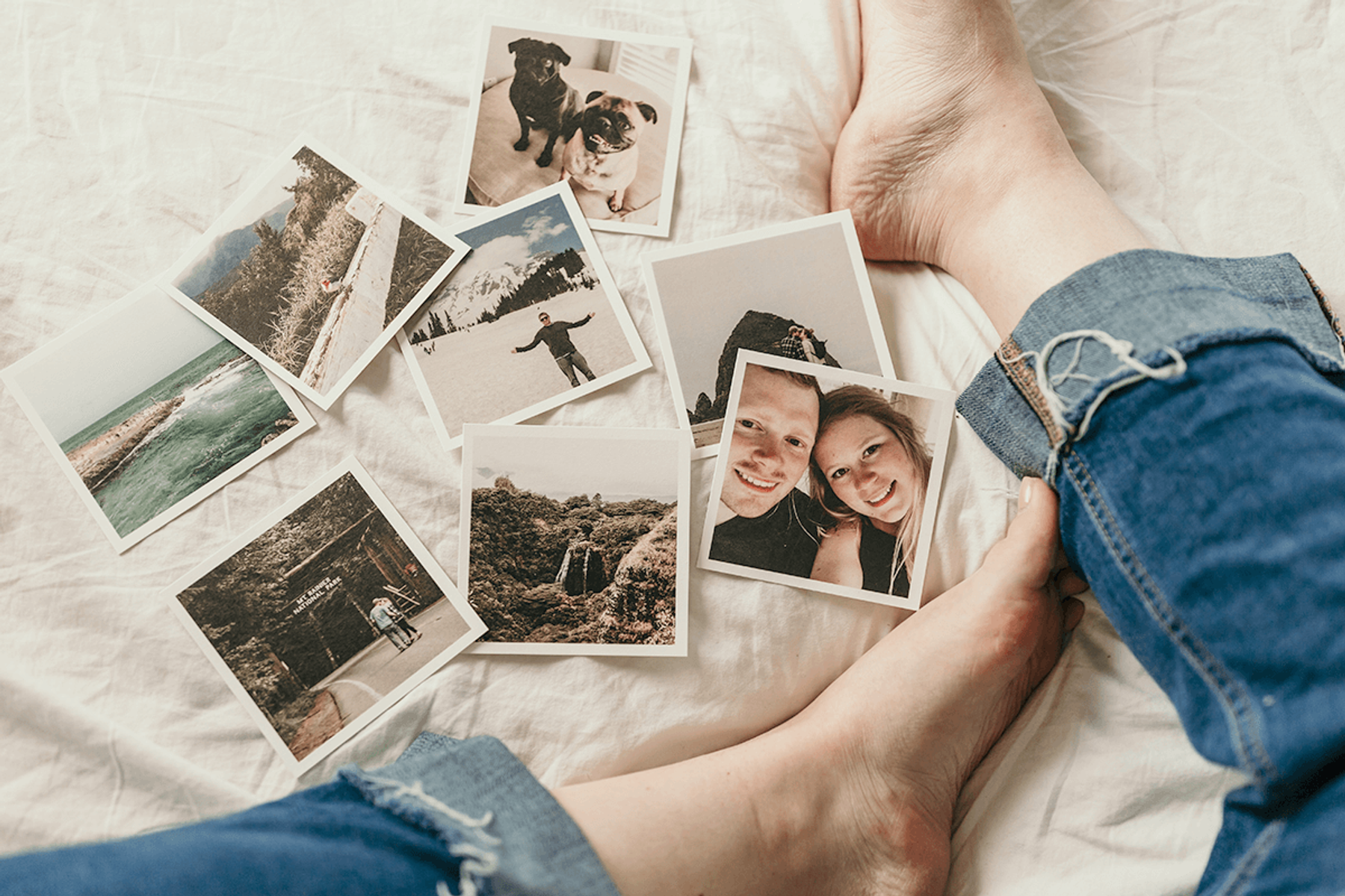 Polaroid pictures from a previous holiday spread out on the bed.
