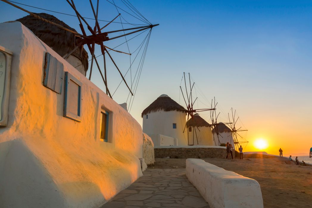 Sunset at the mills in Mykonos, Greece