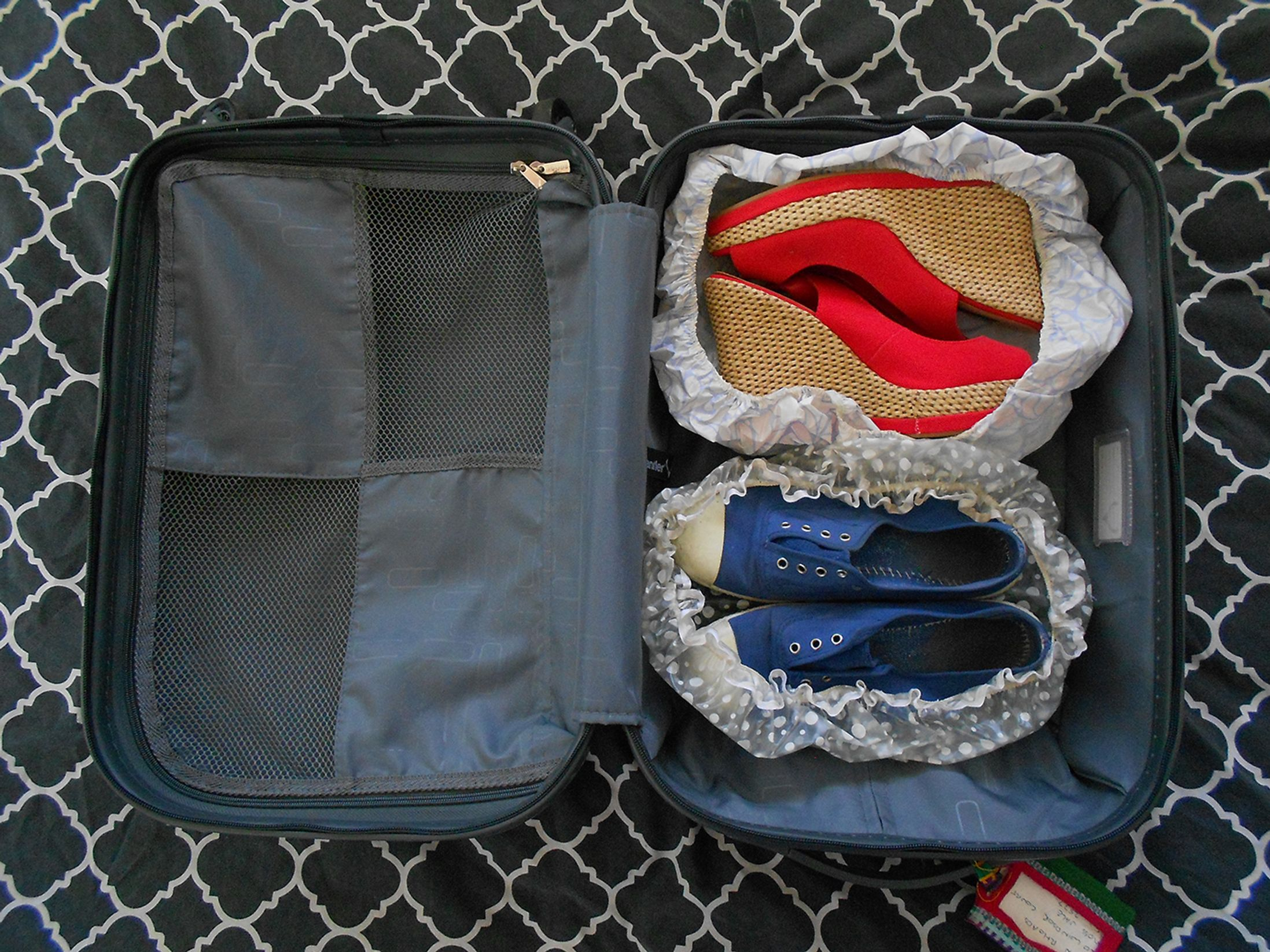 Shoes inside shower caps in a suitcase
